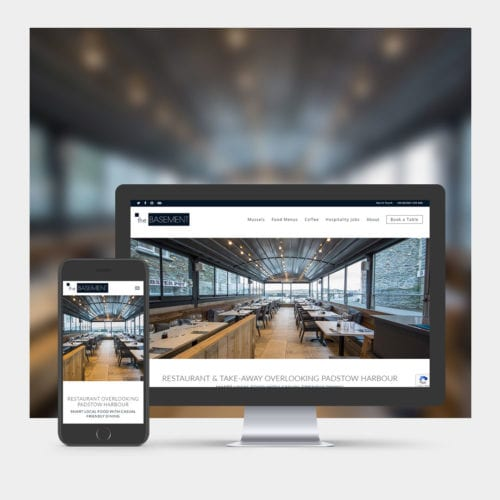 Seafood Restaurant Website Design example on mobile and computer.