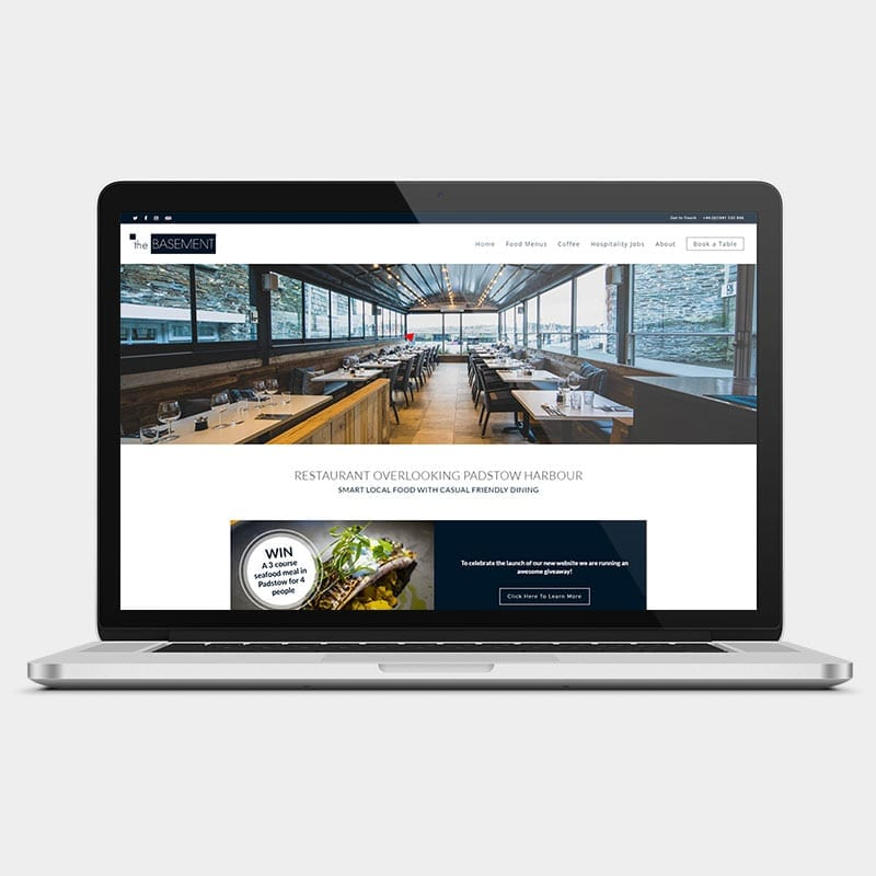 The Basement website on a laptop